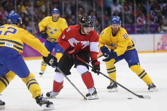Feb 23, 2014; Sochi, RUSSIA; Canada forward Matt Duchene (9) controls the puck against Sweden forward Daniel Sedin (22) and Sweden defenseman Jonathan Ericsson (52) in the men's ice hockey gold medal game during the Sochi 2014 Olympic Winter Games at Bolshoy Ice Dome. Mandatory Credit: Winslow Townson-USA TODAY Sports