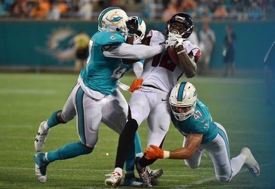 Dolphins cheerl... J Ajayi Dolphins