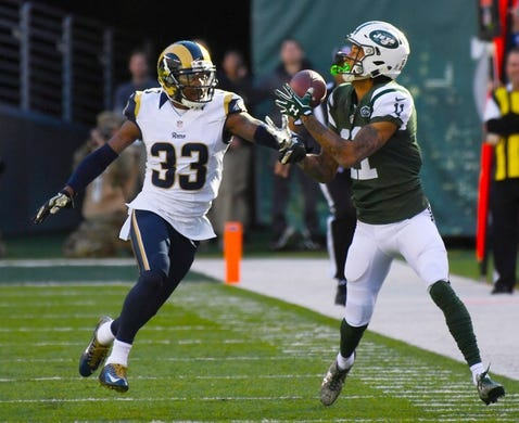 Nov 13, 2016; East Rutherford, NJ, USA;  New York Jets wide receiver Robby Anderson (11) hauls in a long pass in front of Los Angeles Rams cornerback E.J. Gaines (33) in the first half at MetLife Stadium. Mandatory Credit: Robert Deutsch-USA TODAY Sports