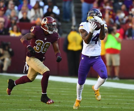 Nov 13, 2016; Landover, MD, USA; Minnesota Vikings wide receiver Stefon Diggs (14) makes a catch over Washington Redskins cornerback Kendall Fuller (38) during the first half at FedEx Field. Mandatory Credit: Brad Mills-USA TODAY Sports
