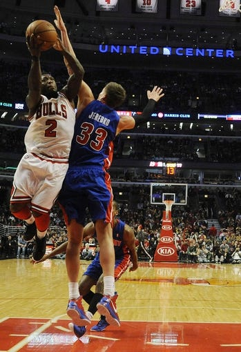 Mar 31, 2013; Chicago, IL, USA; Chicago Bulls point guard Nate Robinson (2) shoots over Detroit Pistons power forward Jonas Jerebko (33) during the first half at the United Center. Mandatory Credit: David Banks-USA TODAY Sports