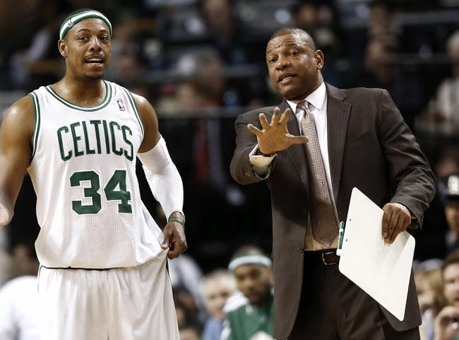 Apr 3, 2013; Boston, MA, USA; Boston Celtics head coach Doc Rivers talks with small forward Paul Pierce during the fourth quarter of Boston's 98-93 win over the Detroit Pistons in an NBA game at TD Garden. Mandatory Credit: Winslow Townson-USA TODAY Sports