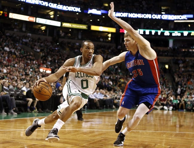 Apr 3, 2013; Boston, MA, USA; Boston Celtics point guard Avery Bradley drives on Detroit Pistons shooting guard Kyle Singler during the fourth quarter of Boston's 98-93 win in an NBA game at TD Garden. Mandatory Credit: Winslow Townson-USA TODAY Sports