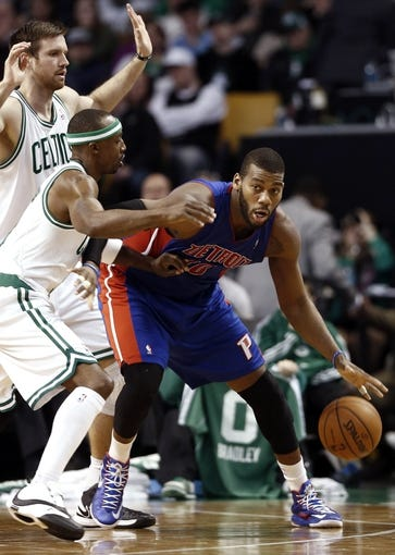 Apr 3, 2013; Boston, MA, USA; Detroit Pistons center Greg Monroe looks to get around Boston Celtics shooting guard Jason Terry and power forward Shavlik Randolph (left) during the fourth quarter of Boston's 98-93 win in an NBA game at TD Garden. Mandatory Credit: Winslow Townson-USA TODAY Sports