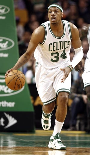 Apr 3, 2013; Boston, MA, USA; Boston Celtics small forward Paul Pierce (34) dribbles the ball up court during the fourth quarter of Boston's 98-93 win over the Detroit Pistons in an NBA game at TD Garden. Mandatory Credit: Winslow Townson-USA TODAY Sports