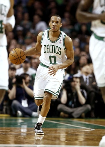 Apr 3, 2013; Boston, MA, USA; Boston Celtics point guard Avery Bradley (0) dribbles the ball up the court during the fourth quarter of Boston's 98-93 win over the Detroit Pistons in an NBA game at TD Garden. Mandatory Credit: Winslow Townson-USA TODAY Sports