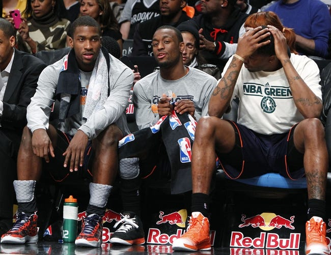 Apr 6, 2013; Brooklyn, NY, USA; Charlotte Bobcats forward Michael Kidd-Gilchrist (14) and Charlotte Bobcats guard Kemba Walker (15) in the fourth quarter against Brooklyn Nets at Barclays Center. Nets won 105-96. Mandatory Credit: Nicole Sweet-USA TODAY Sports