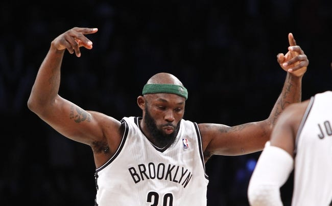 Apr 6, 2013; Brooklyn, NY, USA; Brooklyn Nets forward Reggie Evans (30) reacts in the fourth quarter against Charlotte Bobcats at Barclays Center. Nets won 105-96. Mandatory Credit: Nicole Sweet-USA TODAY Sports