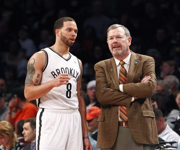 Apr 6, 2013; Brooklyn, NY, USA; Brooklyn Nets guard Deron Williams (8) and Brooklyn Nets head coach P.J. Carlesimo in the second quarter against Charlotte Bobcats at Barclays Center. Mandatory Credit: Nicole Sweet-USA TODAY Sports