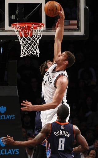 Apr 6, 2013; Brooklyn, NY, USA; Brooklyn Nets center Brook Lopez (11) makes a basket against Charlotte Bobcats guard Ben Gordon (8) in the second quarter at Barclays Center. Mandatory Credit: Nicole Sweet-USA TODAY Sports