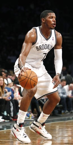 Apr 6, 2013; Brooklyn, NY, USA; Brooklyn Nets guard Joe Johnson (7) looks to pass the ball in the third quarter against Charlotte Bobcats at Barclays Center. Nets won 105-96. Mandatory Credit: Nicole Sweet-USA TODAY Sports