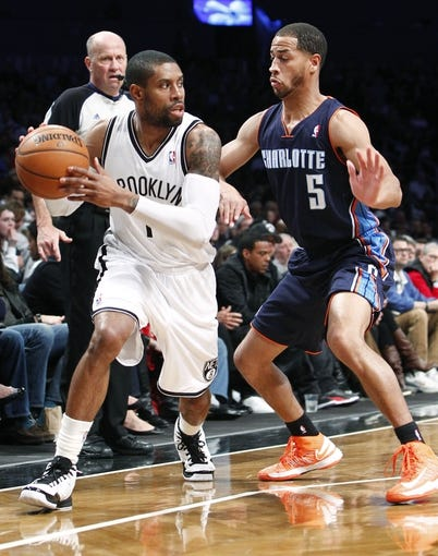 Apr 6, 2013; Brooklyn, NY, USA; Brooklyn Nets guard C.J. Watson (1) looks to pass the ball against Charlotte Bobcats guard Jannero Pargo (5) in the fourth quarter at Barclays Center. Nets won 105-96. Mandatory Credit: Nicole Sweet-USA TODAY Sports