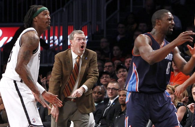 Apr 6, 2013; Brooklyn, NY, USA; Brooklyn Nets forward Gerald Wallace (45) and head coach P.J. Carlesimo and Charlotte Bobcats guard Ben Gordon (8) react in the fourth quarter at Barclays Center. Nets won 105-96. Mandatory Credit: Nicole Sweet-USA TODAY Sports