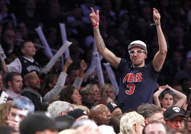 Apr 6, 2013; Brooklyn, NY, USA; A fan celebrates during the fourth quarter in the game between the Charlotte Bobcats and the Brooklyn Nets at Barclays Center. Nets won 105-96. Mandatory Credit: Nicole Sweet-USA TODAY Sports
