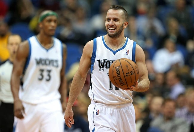 Apr 6, 2013; Minneapolis, MN, USA; Minnesota Timberwolves point guard J.J. Barea (11) smiles after getting a foul called on him in the second half against the Detroit Pistons at Target Center. The Timberwolves won 107-101. Mandatory Credit: Jesse Johnson-USA TODAY Sports