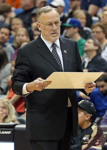 Apr 6, 2013; Minneapolis, MN, USA; Minnesota Timberwolves head coach Rick Adelman looks to his whiteboard during a timeout in the second half against the Detroit Pistons at Target Center. The Timberwolves won 107-101. Mandatory Credit: Jesse Johnson-USA TODAY Sports