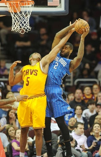Apr 7, 2013; Cleveland, OH, USA; Cleveland Cavaliers power forward Kevin Jones (5) and Orlando Magic power forward Kyle O'Quinn (2) battle for a rebound during the game at Quicken Loans Arena. Mandatory Credit: Eric P. Mull-USA TODAY Sports