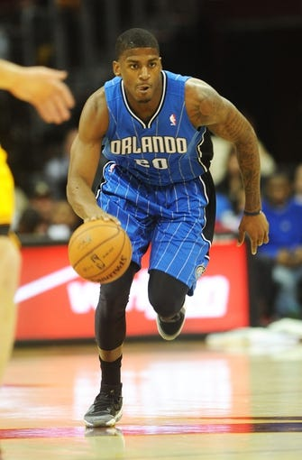 Apr 7, 2013; Cleveland, OH, USA; Orlando Magic small forward DeQuan Jones (20) brings the ball up court during the game against the Cleveland Cavaliers at Quicken Loans Arena. Mandatory Credit: Eric P. Mull-USA TODAY Sports