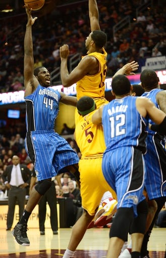 Apr 7, 2013; Cleveland, OH, USA; Orlando Magic power forward Andrew Nicholson (44) shoots over Cleveland Cavaliers power forward Tristan Thompson (13) during the game at Quicken Loans Arena. Mandatory Credit: Eric P. Mull-USA TODAY Sports