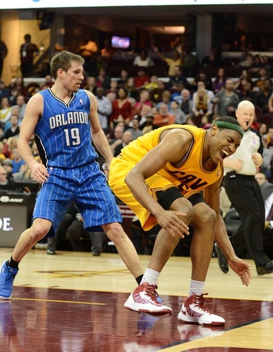 Apr 7, 2013; Cleveland, OH, USA; Cleveland Cavaliers power forward Kevin Jones (5) reacts after losing the ball out of bounds against the Orlando Magic during the game at Quicken Loans Arena. Mandatory Credit: Eric P. Mull-USA TODAY Sports