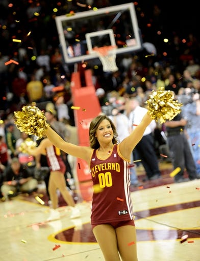 Apr 7, 2013; Cleveland, OH, USA; A Cleveland Cavalier cheerleader celebrates after the game against the Orlando Magic at Quicken Loans Arena. The Cavaliers beat the Magic 91-85Mandatory Credit: Eric P. Mull-USA TODAY Sports
