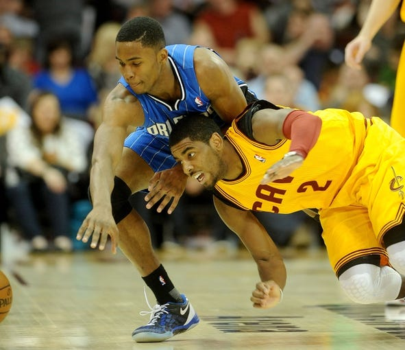 Apr 7, 2013; Cleveland, OH, USA; Cleveland Cavaliers point guard Kyrie Irving (2) and Orlando Magic small forward Maurice Harkless (21) go for a loose ball during the game at Quicken Loans Arena. Mandatory Credit: Eric P. Mull-USA TODAY Sports