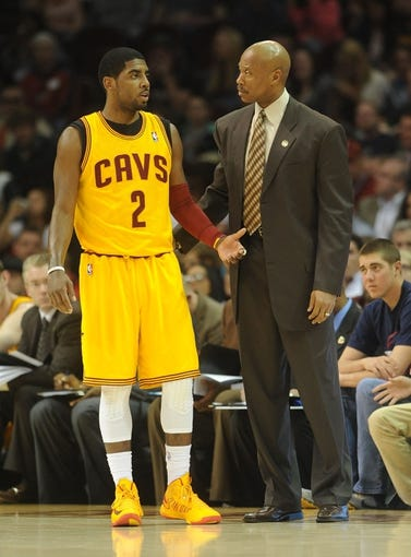 Apr 7, 2013; Cleveland, OH, USA; Cleveland Cavaliers point guard Kyrie Irving (2) talks with head coach Byron Scott during the game against the Orlando Magic at Quicken Loans Arena. Mandatory Credit: Eric P. Mull-USA TODAY Sports