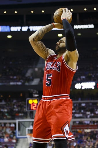 April 7, 2013; Auburn Hills, MI, USA; Chicago Bulls power forward Carlos Boozer (5) shoots the ball in the first quarter against the Detroit Pistons at The Palace. Mandatory Credit: Rick Osentoski-USA TODAY Sports