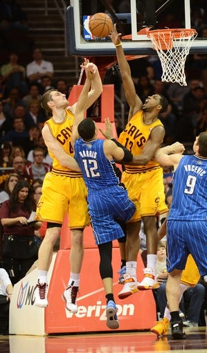 Apr 7, 2013; Cleveland, OH, USA; Cleveland Cavaliers power forward Tristan Thompson (13) blocks the shot of Orlando Magic small forward Tobias Harris (12) during the game at Quicken Loans Arena. Mandatory Credit: Eric P. Mull-USA TODAY Sports