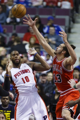 April 7, 2013; Auburn Hills, MI, USA; Detroit Pistons center Greg Monroe (10) and Chicago Bulls center Joakim Noah (13) go for a rebound in the first quarter at The Palace. Mandatory Credit: Rick Osentoski-USA TODAY Sports