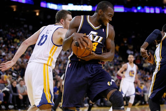 Apr 7, 2013; Oakland, CA, USA; Utah Jazz forward Paul Millsap (24) holds onto a rebound against the Golden State Warriors in the second quarter at ORACLE arena. Mandatory Credit: Cary Edmondson-USA TODAY Sports