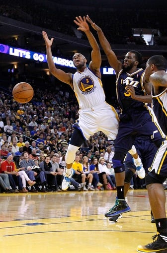 Apr 7, 2013; Oakland, CA, USA; Golden State Warriors guard Jarrett Jack (2) has the ball knocked out of his hands by Utah Jazz forward DeMarre Carroll (3) in the second quarter at ORACLE arena. Mandatory Credit: Cary Edmondson-USA TODAY Sports