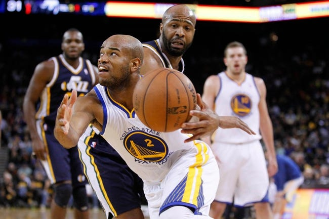 Apr 7, 2013; Oakland, CA, USA; Golden State Warriors guard Jarrett Jack (2) drives past Utah Jazz guard Jamaal Tinsley (6) in the second quarter at ORACLE arena. Mandatory Credit: Cary Edmondson-USA TODAY Sports
