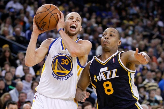 Apr 7, 2013; Oakland, CA, USA; Golden State Warriors guard Stephen Curry (30) prepares to attempt a shot over Utah Jazz guard Randy Foye (8) in the second quarter at ORACLE arena. Mandatory Credit: Cary Edmondson-USA TODAY Sports