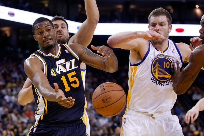 Apr 7, 2013; Oakland, CA, USA; Utah Jazz forward Derrick Favors (15) attempts to grab a rebound next to Golden State Warriors forward David Lee (10) in the second quarter at ORACLE arena. Mandatory Credit: Cary Edmondson-USA TODAY Sports