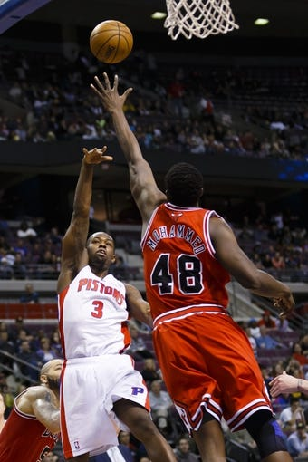 April 7, 2013; Auburn Hills, MI, USA; Detroit Pistons point guard Rodney Stuckey (3) shoots the ball over Chicago Bulls center Nazr Mohammed (48) in the fourth quarter at The Palace. Detroit won 99-85. Mandatory Credit: Rick Osentoski-USA TODAY Sports