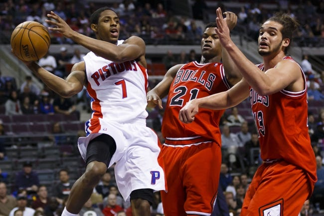 April 7, 2013; Auburn Hills, MI, USA; Detroit Pistons point guard Brandon Knight (7) passes the ball on Chicago Bulls small forward Jimmy Butler (21) and center Joakim Noah (13) in the fourth quarter at The Palace. Detroit won 99-85. Mandatory Credit: Rick Osentoski-USA TODAY Sports