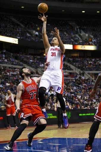 April 7, 2013; Auburn Hills, MI, USA; Detroit Pistons power forward Charlie Villanueva (31) shoots the ball on Chicago Bulls small forward Vladimir Radmanovic (77) in the fourth quarter at The Palace. Detroit won 99-85. Mandatory Credit: Rick Osentoski-USA TODAY Sports