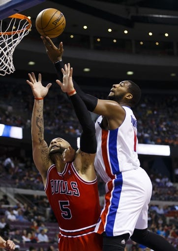 April 7, 2013; Auburn Hills, MI, USA; Detroit Pistons center Andre Drummond (1) goes to the basket on Chicago Bulls power forward Carlos Boozer (5) in the third quarter at The Palace. Detroit won 99-85. Mandatory Credit: Rick Osentoski-USA TODAY Sports