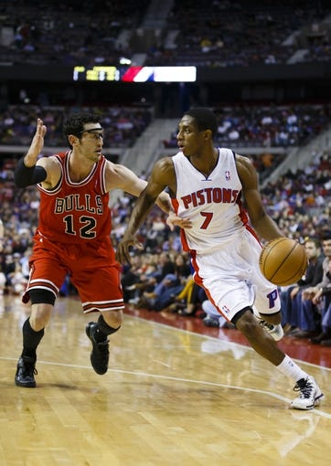 April 7, 2013; Auburn Hills, MI, USA; Detroit Pistons point guard Brandon Knight (7) moves the ball on Chicago Bulls shooting guard Kirk Hinrich (12) in the third quarter at The Palace. Detroit won 99-85. Mandatory Credit: Rick Osentoski-USA TODAY Sports
