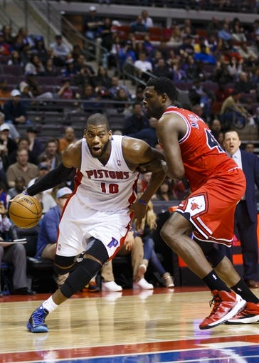 April 7, 2013; Auburn Hills, MI, USA; Detroit Pistons center Greg Monroe (10) is guarded by Chicago Bulls center Nazr Mohammed (48) in the third quarter at The Palace. Detroit won 99-85. Mandatory Credit: Rick Osentoski-USA TODAY Sports