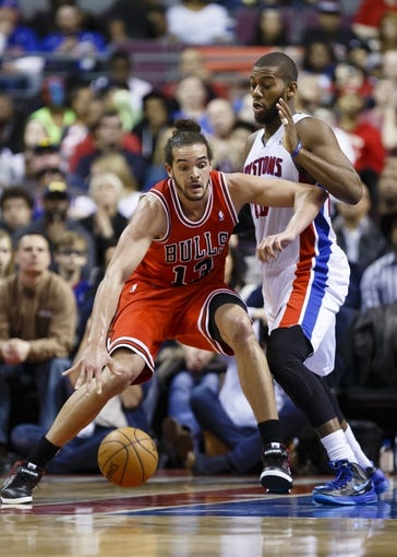 April 7, 2013; Auburn Hills, MI, USA; Chicago Bulls center Joakim Noah (13) is guarded by Detroit Pistons center Greg Monroe (10) in the fourth quarter at The Palace. Mandatory Credit: Rick Osentoski-USA TODAY Sports