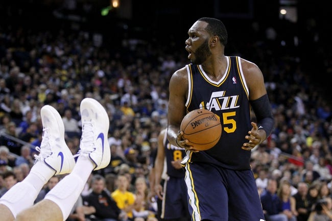 Apr 7, 2013; Oakland, CA, USA; Utah Jazz center Al Jefferson (25) reacts after being called for an offensive foul on Golden State Warriors center Andrew Bogut (not pictured) in the third quarter at ORACLE arena. The Jazz defeated the Warriors 97-90. Mandatory Credit: Cary Edmondson-USA TODAY Sports