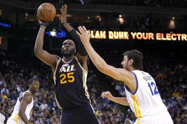 Apr 7, 2013; Oakland, CA, USA; Utah Jazz center Al Jefferson (25) attempts a shot over Golden State Warriors center Andrew Bogut (12) in the third quarter at ORACLE arena. The Jazz defeated the Warriors 97-90. Mandatory Credit: Cary Edmondson-USA TODAY Sports