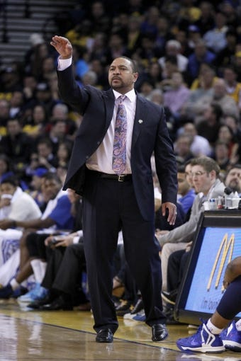 Apr 7, 2013; Oakland, CA, USA; Golden State Warriors head coach Mark Jackson calls a play against the Utah Jazz in the third quarter at ORACLE arena. The Jazz defeated the Warriors 97-90. Mandatory Credit: Cary Edmondson-USA TODAY Sports