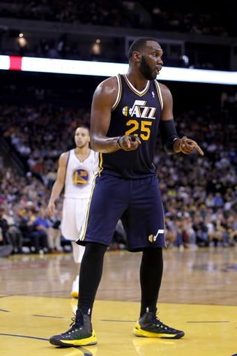 Apr 7, 2013; Oakland, CA, USA; Utah Jazz center Al Jefferson (25) reacts after making a shot while being fouled against the Golden State Warriors in the third quarter at ORACLE arena. The Jazz defeated the Warriors 97-90. Mandatory Credit: Cary Edmondson-USA TODAY Sports