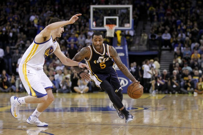 Apr 7, 2013; Oakland, CA, USA; Utah Jazz guard Mo Williams (5) drives past Golden State Warriors guard Klay Thompson (11) in the fourth quarter at ORACLE arena. The Jazz defeated the Warriors 97-90. Mandatory Credit: Cary Edmondson-USA TODAY Sports