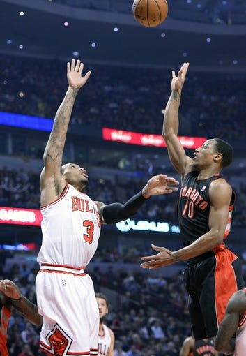 Apr 9, 2013; Chicago, IL, USA; Toronto Raptors shooting guard DeMar DeRozan (10) shoots the ball over Chicago Bulls power forward Malcolm Thomas (3) during the first half at the United Center. Mandatory Credit: Mike DiNovo-USA TODAY Sports