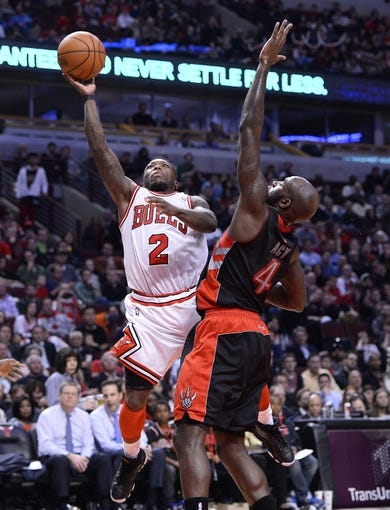 Apr 9, 2013; Chicago, IL, USA; Chicago Bulls point guard Nate Robinson (2) shoots the ball against Toronto Raptors small forward Quincy Acy (4) during the second half at the United Center. Toronto defeats Chicago 101-98. Mandatory Credit: Mike DiNovo-USA TODAY Sports