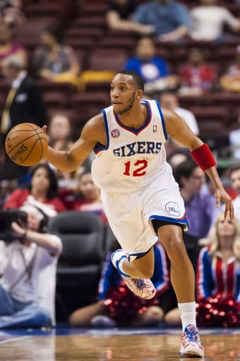 Apr 10, 2013; Philadelphia, PA, USA; Philadelphia 76ers guard Evan Turner (12) brings the ball up court during the first quarter against the Atlanta Hawks at the Wells Fargo Center. Mandatory Credit: Howard Smith-USA TODAY Sports